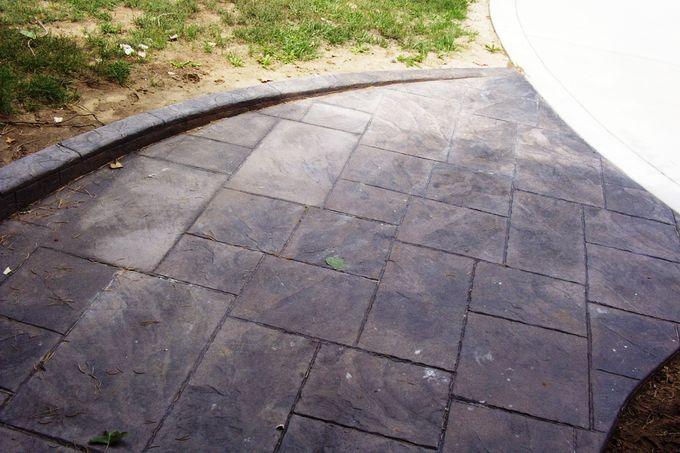 Large ashlar slate walk with sloping curb