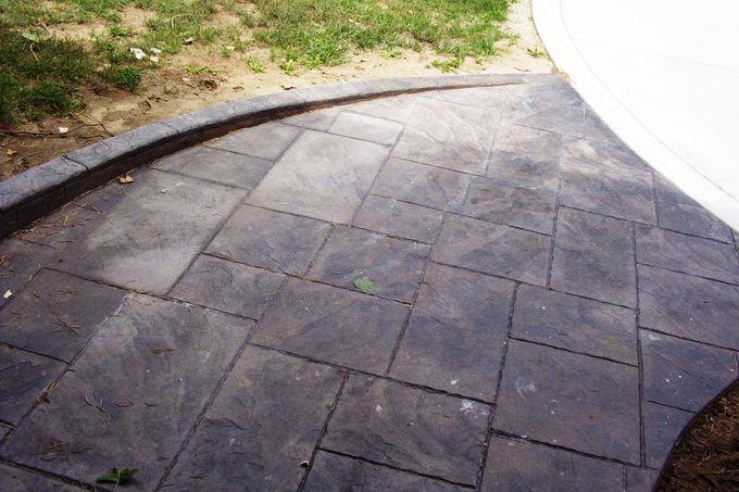 Large ashlar slate walk with sloping curb