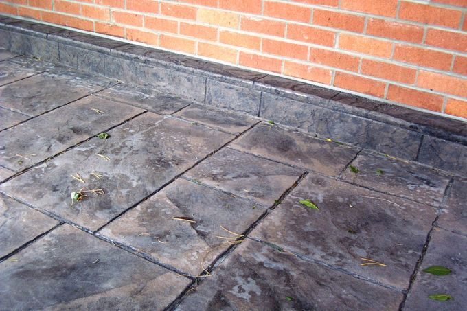 Stamped curb to cover exposed foundation wall at 2300 Kohler, Boulder