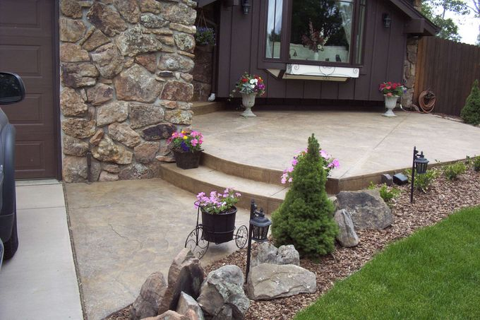 Seamless stone entry, walk to driveway Mackell Home, 4269 Carter Tr.