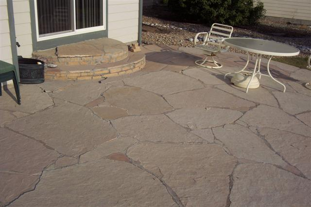 This is the existing patio replaced with large ashlar slate.
