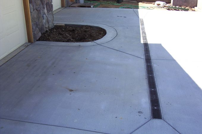 The drive has a channel drain as the garage is lower than the street.