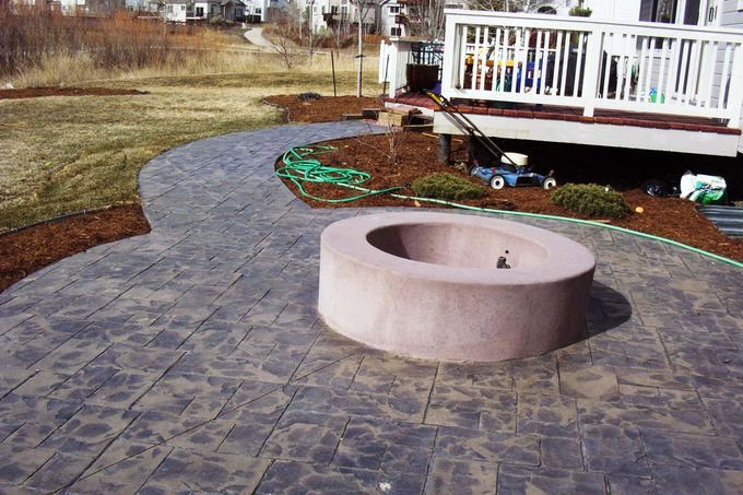 Poured concrete fire pit and cut ashlar slate patio